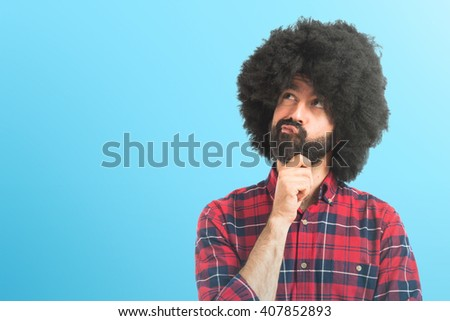 Afro man thinking over white background   - stock photo