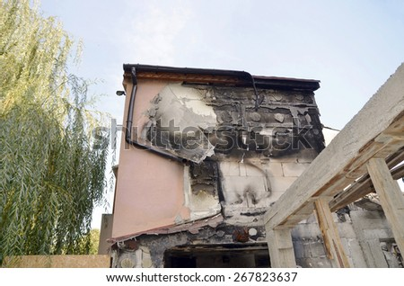 After a fire, detail view of a burnt-out building, view of a   building  - stock photo