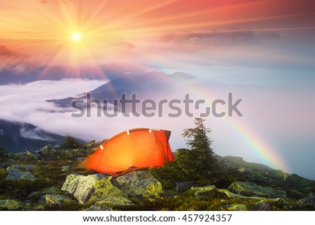 after a rain on a background of fog Ukrainian mountain ridges. Panoramic views from the top of the Hamster, which sleeps Ukrainian tourists for beautiful panoramas Carpathians dawn - stock photo