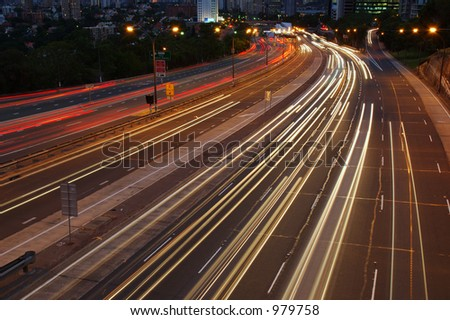 After Dark. Cars traveling on a motorway at night. - stock photo