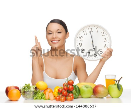 after six o'clock diet - happy woman with fruits and vegetables - stock photo