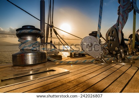 after the regatta, sunset from sailboat - stock photo