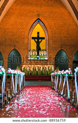 After wedding ceremony in church in front of Jesus - stock photo