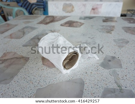 After wet of Toilet paper on the table. - stock photo