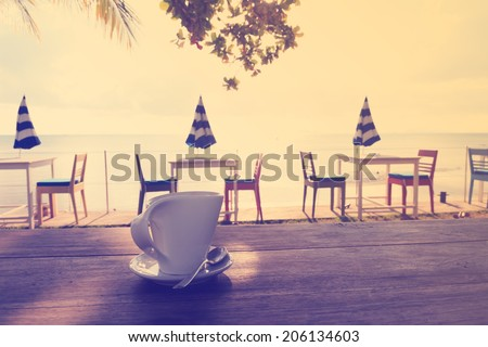 Afternoon coffee break by the beach in vintage style - stock photo