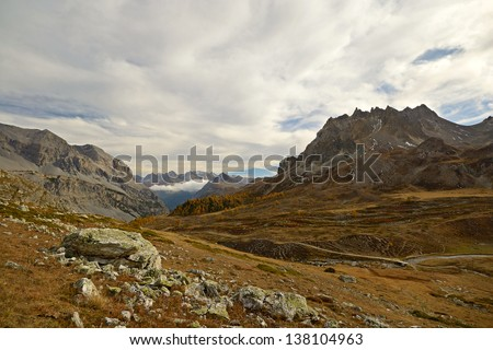 Afternoon light in an idyllic dolomitic-like high mountain scenery in the italian french Alps. - stock photo