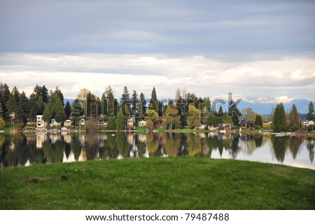 Afternoon reflection on Angle Lake near Seattle airport - stock photo