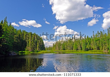 Afternoon shadows on Rib Lake in the Boundary Waters - stock photo