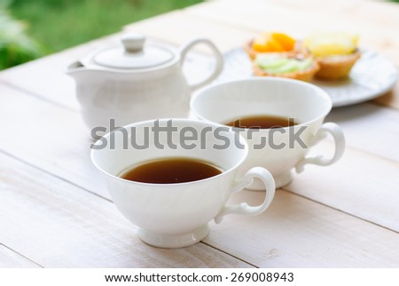 Afternoon tea with cake - stock photo