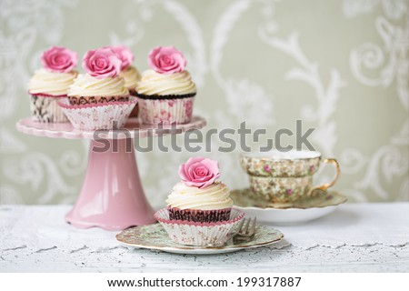 Afternoon tea with rose cupcakes - stock photo