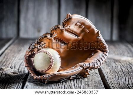 Age Baseball glove and ball - stock photo