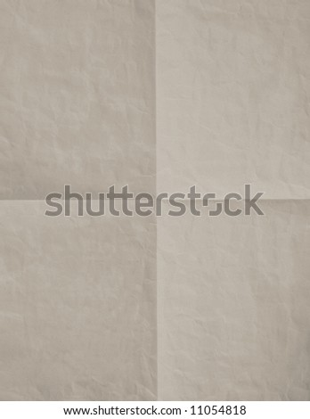 Aged and folded paper background. - stock photo