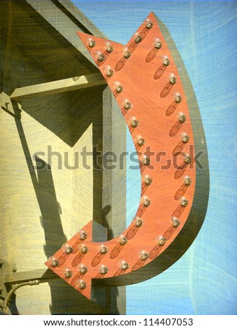aged and worn vintage photo of arrow on building - stock photo