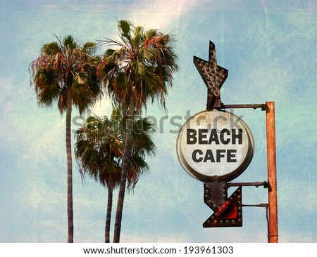 aged and worn vintage photo of beach cafe sign with palm trees - stock photo