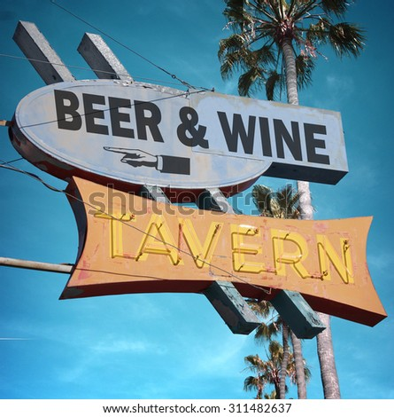 aged and worn vintage photo of beer and wine tavern neon sign                                - stock photo