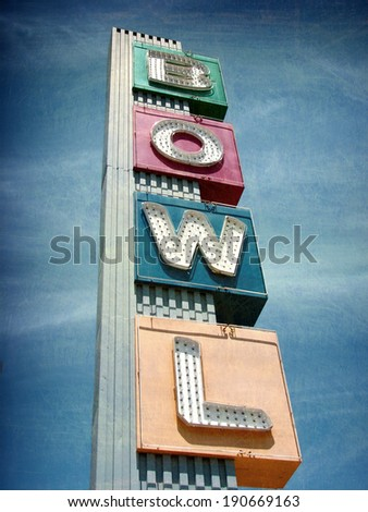aged and worn vintage photo of bowling alley sign - stock photo