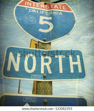 aged and worn vintage photo of california freeway interstate sign - stock photo