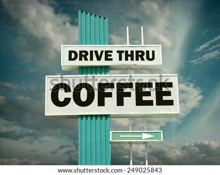 aged and worn vintage photo of coffee drive thru sign                              - stock photo