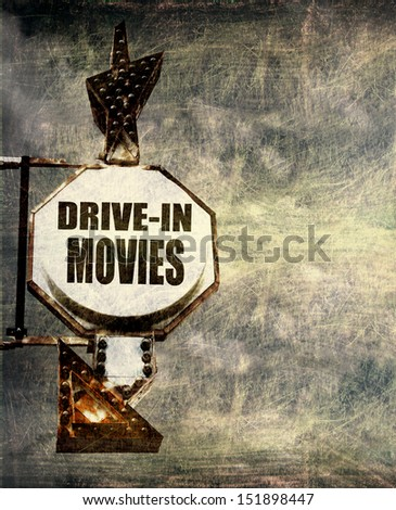 aged and worn vintage photo of drive in movies sign with room for text                               - stock photo