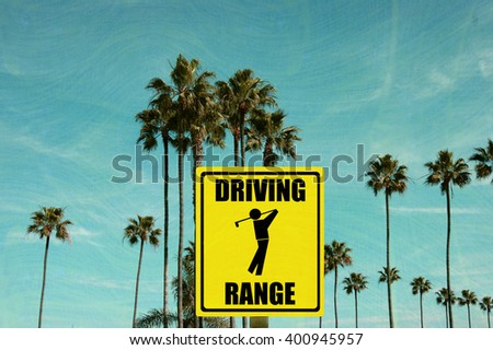 aged and worn vintage photo of driving range sign with palm trees - stock photo
