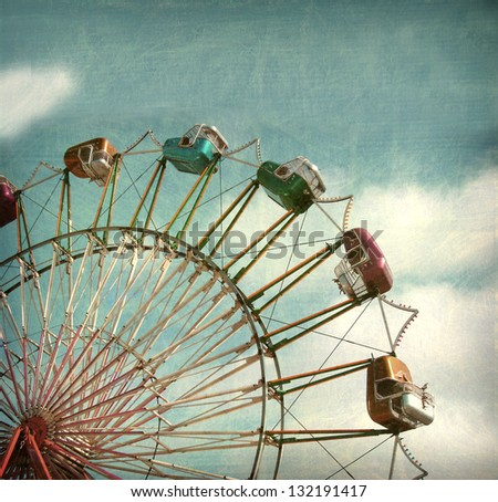 aged and worn vintage photo of ferris wheel - stock photo