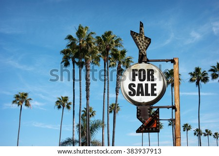 aged and worn vintage photo of for sale sign with palm trees  - stock photo