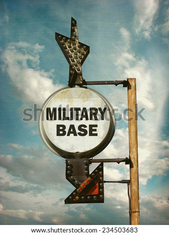 aged and worn vintage photo of military base sign                               - stock photo