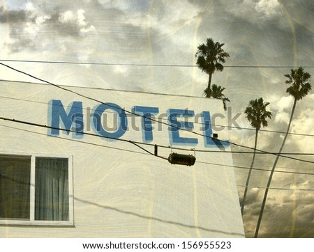 aged and worn vintage photo of motel with palm trees - stock photo