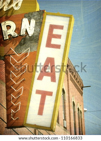 aged and worn vintage photo of neon eat sign - stock photo