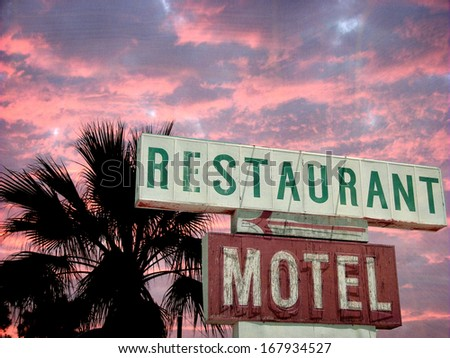 aged and worn vintage photo of neon sign at sunset                               - stock photo