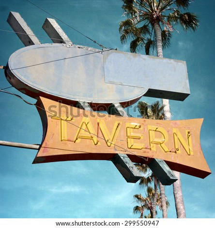 aged and worn vintage photo of neon sign with palm tree - stock photo