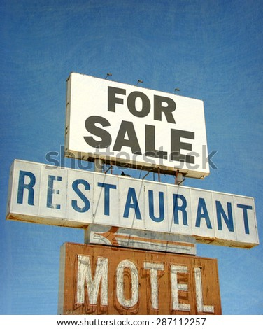 aged and worn vintage photo of  of old restaurant and motel for sale                              - stock photo