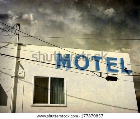 aged and worn vintage photo of old motel                               - stock photo