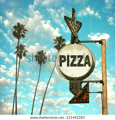 aged and worn vintage photo of pizza sign with palm trees - stock photo