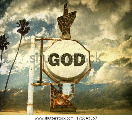 aged and worn vintage photo of sign pointing to god                                - stock photo