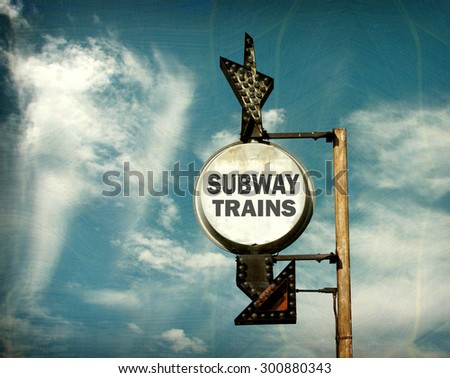 aged and worn vintage photo of subway trains sign                               - stock photo