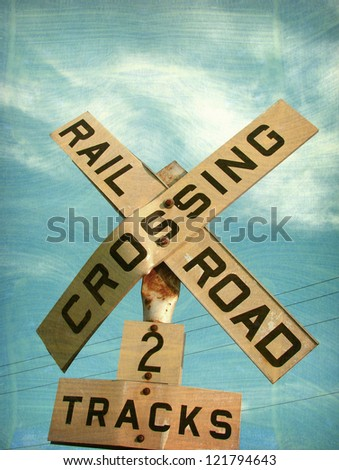 aged and worn vintage railroad crossing sign - stock photo