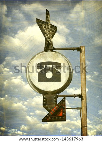 aged and worn vintage telephone sign - stock photo