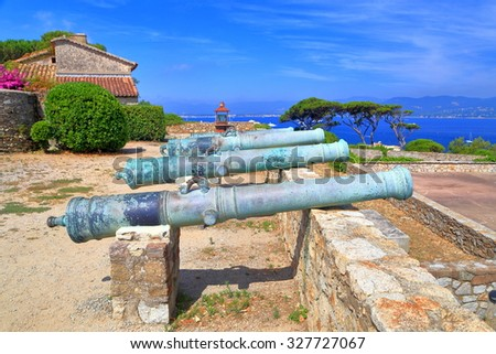 Aged barrels of medieval canons on the walls of Saint Tropez fortress, French Riviera, France - stock photo