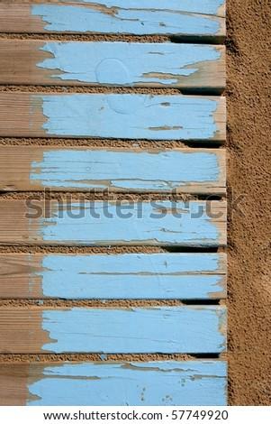 aged beach blue wooden floor over summer sand - stock photo