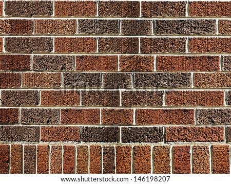 aged brown brick wall - stock photo