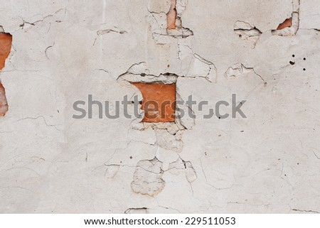 Aged cement wall with red brick - stock photo
