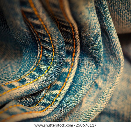aged Jeans with yellow stitching thread, close up. small depth sharpness. instagram image retro style - stock photo