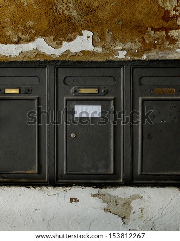 Aged metal mailboxes on old stone wall. Typical European. - stock photo