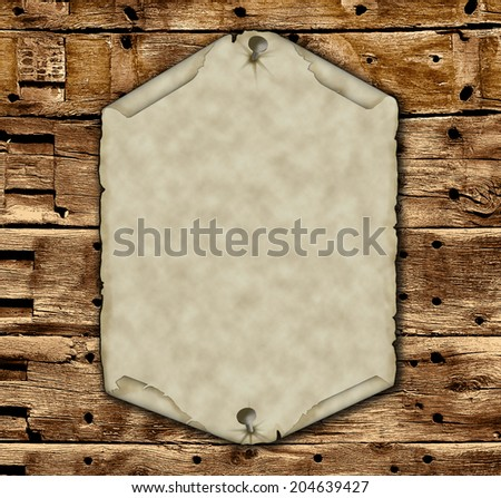 Aged, natural parchment pinned to an an old wooden wall. - stock photo