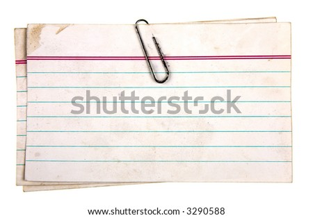 Aged note papers fastened with a clip - stock photo