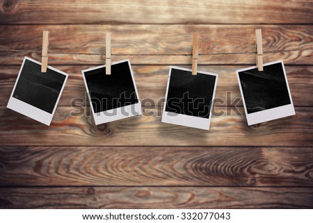 Aged old photo frames on a wooden background - stock photo