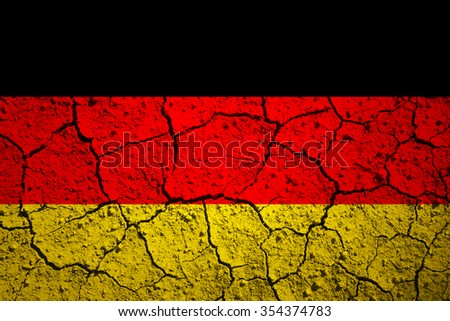 Aged old textured Germany flag. Grunge cracked soil effect used. - stock photo