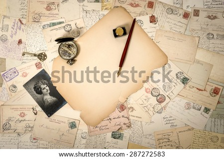 Aged papers, antique accessories and old postcards. Sentimental vintage background - stock photo