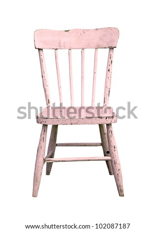 aged pink wooden child's chair on a white background - stock photo